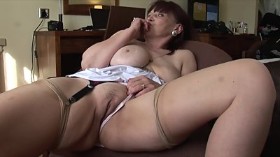 Busty mature Tanya in stockings and..