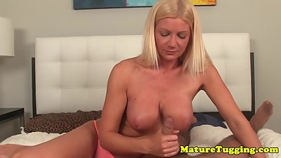 Beautiful handjob MILF jerks cock POV