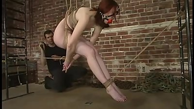 classic rope bondage red head whipped..