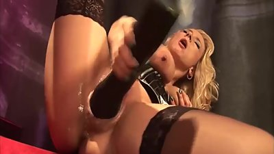 MILF Using Plastic Fist in Pussy