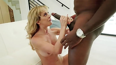 Busty MILF Cherie DeVille bounces on bbc