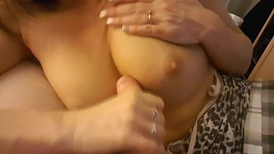 Busty milf jerks a thick cock to get a..