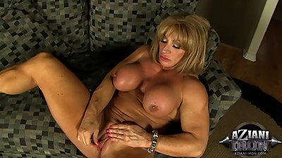 Freaky Muscle Milf Pumps Her Large Clit