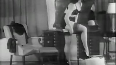 Betty Page gets dressed