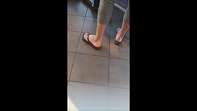 Blonde milf feet at restaurant