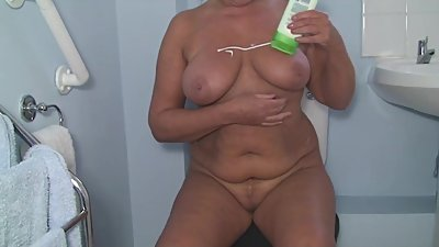 April Thomas Rubs Lotion Over Her Body