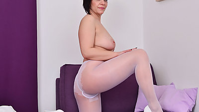 Euro and nyloned milf Nicol rubs her..