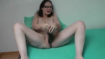 Sabine playing with her huge dildo