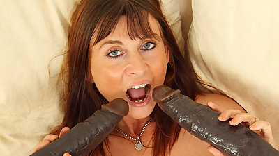 English milf Lelani gets busy with two..