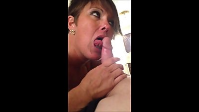 shorth haired milf giving head