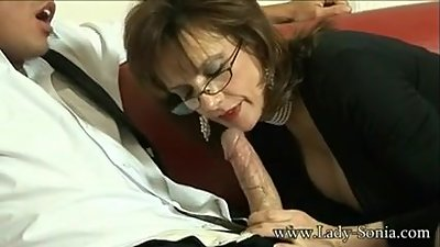 British Milf Lady Sonia sucks a huge..