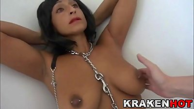 Submissive brunette MILF chained in a..