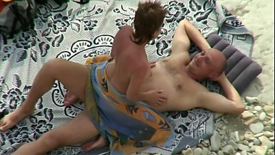 Sex on the beach. Mature couple