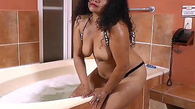 Latina milf Sharon gets turned on in..