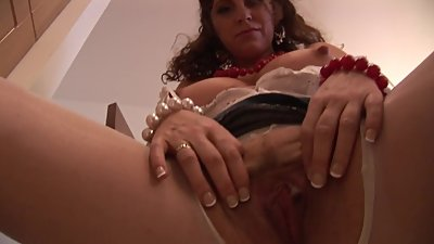 Mature babe Gilly Sampson masturbates..