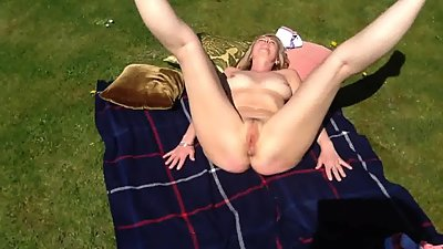 Shy british milf in her garden