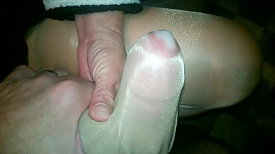 Nylon Handjob with cum on shiny nylon..